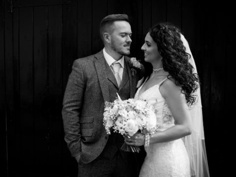Black & white photo of the bride & groom on their wedding at King Arthur Hotel Gower